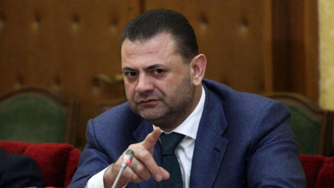 Lawmaker Tom Doshi speaks to a Parliament's commission discussing the prosecutors' request to lift his immunity, Wednesday, March 25, 2015, after his claims Speaker Ilir Meta had been behind an assassination plot. Parliament on Thursday, March 26, 2015 voted in favor of the prosecutors' call to arrest Doshi, expelled from the governing Socialists three weeks ago after the claims, and also for Christian Democrat Mark Frroku for false testimony in the case. (AP Photo/Hektor Pustina)